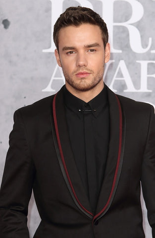 Liam Payne in black and red suit