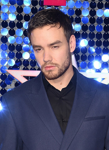 Liam Payne in blue jacket and black shirt