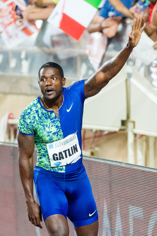 Justin Gatlin thanking his fans as he wins mens 100m race