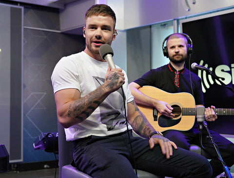 Liam Payne muscly arms and white tee with guitarist