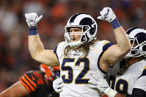 clay matthews biceps white top muscles