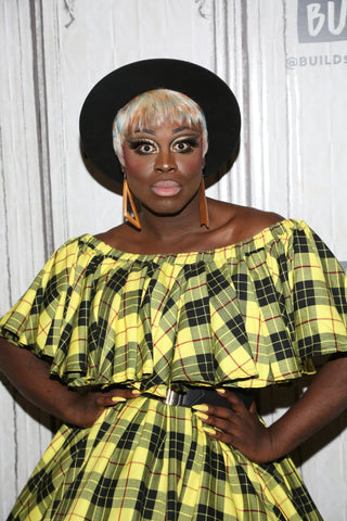 Bob The Drag Queen in yellow and black dress, white short wig and black hat