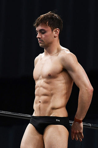 Tom Daley muscles out tiny trunks