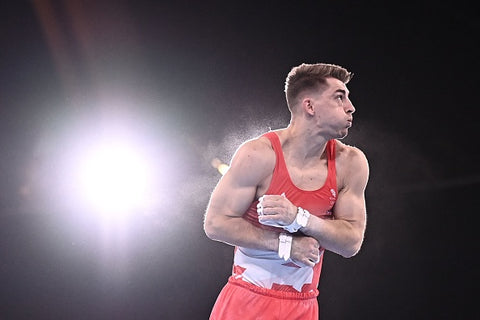 Max Whitlock with red vest and muscles