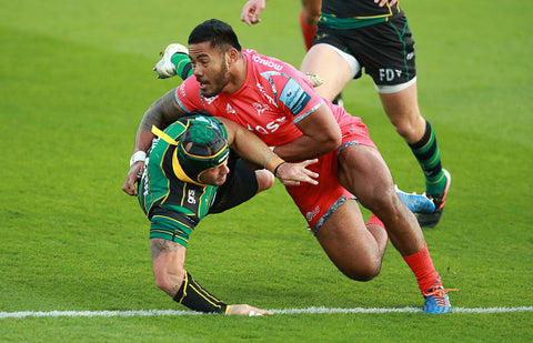 Manu Tuilagi in action on pitch red kit