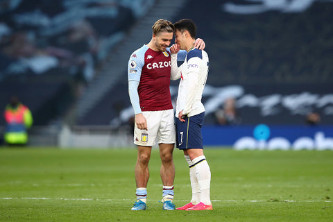 Jack Grealish chats with mate on opposing team