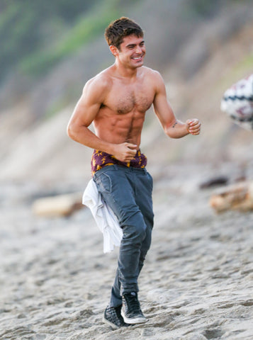 Zac Efron topless on beach