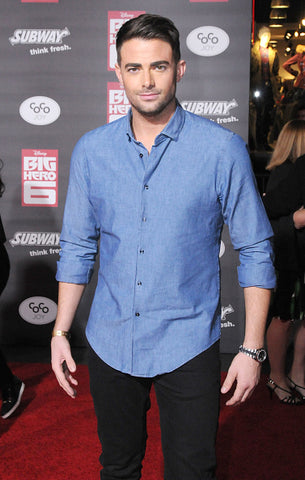 Aaron Samuels Jonathan Bennett wearing a blue cotton shirt and black jeans