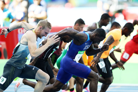 Justin Gatlin giving it everything he's got to win race against fellow olympians