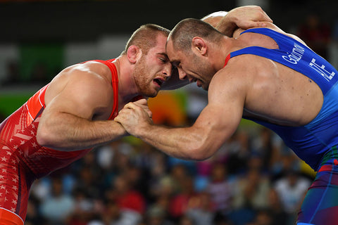 Kyle Frederick Snyder (Red) of the United States competes against Khetag Goziumov (blue) of Azerbaijan