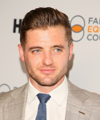 Robbie Rogers in grey suit and blue tie