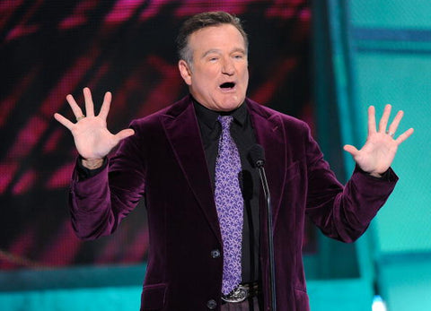 Robin Williams wearing a purple suit at People Choice Awards.