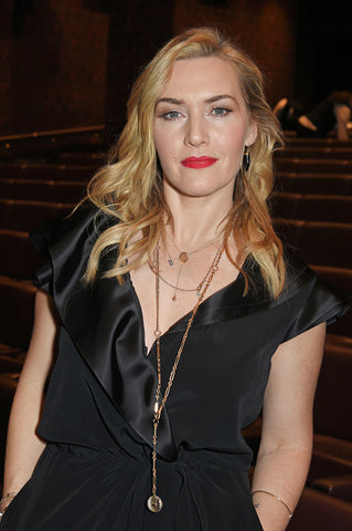 Kate winslet black top and blond hair and red lipstick