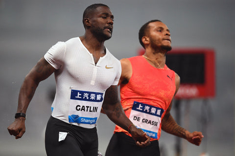Justin Gatlin shows pectorals and nipples as he runs against De Graasse