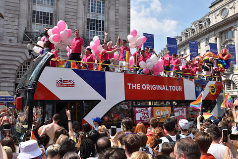 london bus and pride revellers
