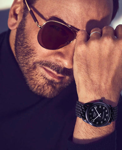 tom ford in glasses and black top