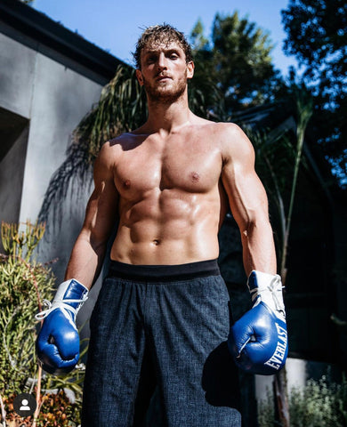 Logan paul topless with blue boxing gloves