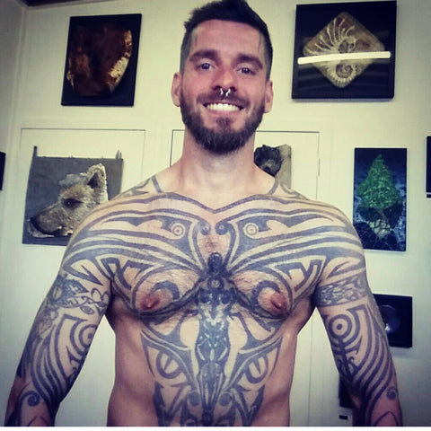 Phillip Tanzer topless with tattoos and piercings