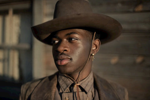 lil nas x with stetson and brown jacket