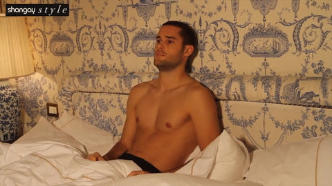 Mario Suarez topless in bed showing his toned body
