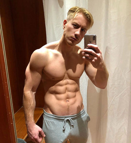 Kris Boyson in bulging grey pants and topless with muscles