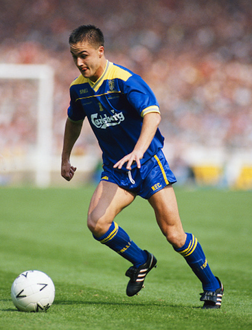 Dennis Wise wearing short retro football shorts in 1988