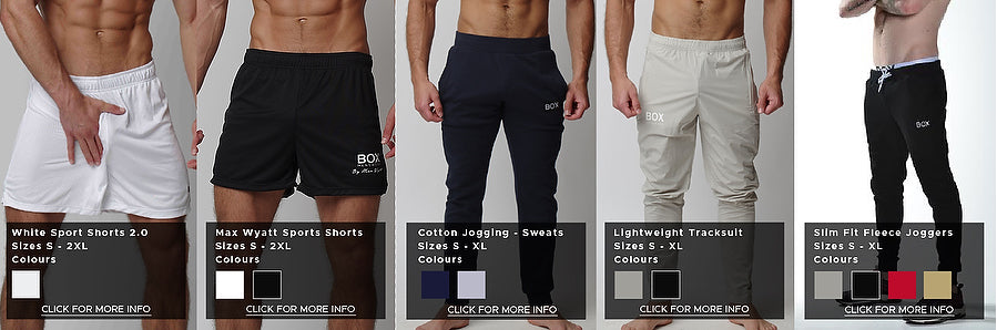 Five product photos side by side providing a comparison of fit and styles. From left to right, pictures jersey sports shorts in white and small black box logo on lower left thigh fits just above knee, black max wyatt sport shorts with max wyatt logo in white on bottom of left leg in white fits slightly higher than normal sport shorts, cotton joggers in navy features thick material with stitch box logo on left thigh in a slim fit, lightweight jogger in stone colour featuring a tight fitting polyester material with larger printed box logo on left thigh and fleece joggers in black with a thinner cotton material featuring smaller stitched box logo on left thigh