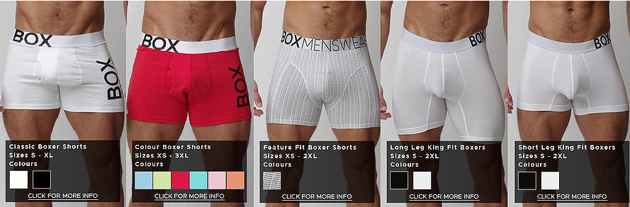 "Five product photos side by side providing a comparison of fit and styles. From left to right, pictures white cotton classic boxer shorts with logo on waistband and left leg, red boxers the same style as the white, feature fit boxers featuring mini text design saying ""fuck you"" with a tighter fit and longer leg, white king fit boxers with transparent crotch and legs go 6 inches down the thigh and next to king fit white boxers with transparent crotch but shorter 4 inch legs slightly higher up the thigh"