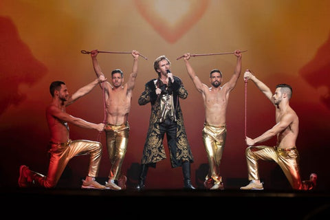 Dan Stevens performs on stage with near naked male dancers