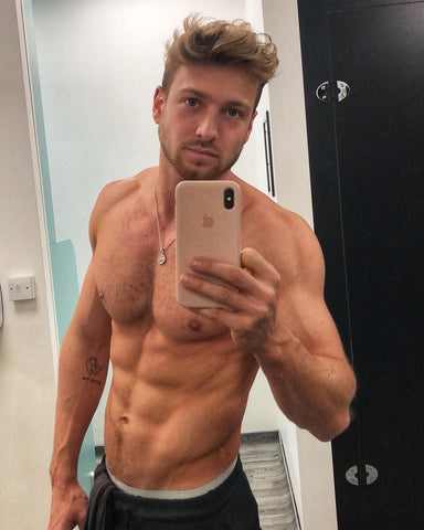 Sam Thompson takes a mirror selfie topless with buff bod