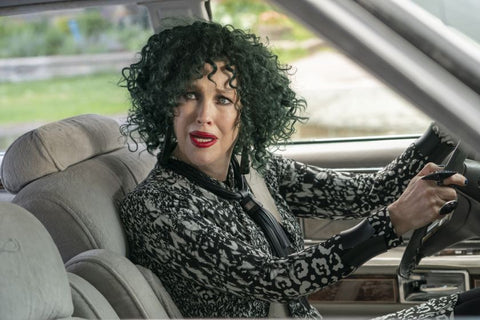 Catherine O'Hara as Moira Rose in green curly ig