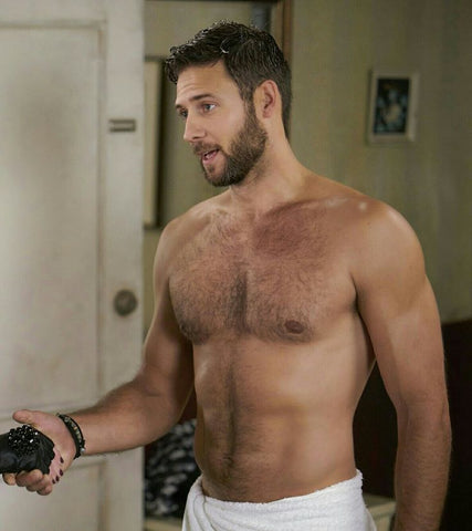 Steve Lund topless with towel wrapped around waist