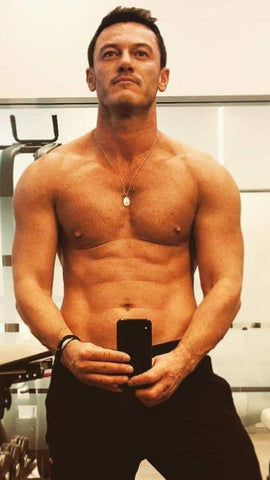 selfie by luke evans in gym topless