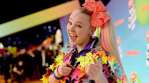 Jojo Siwa looking happy and right with confetti