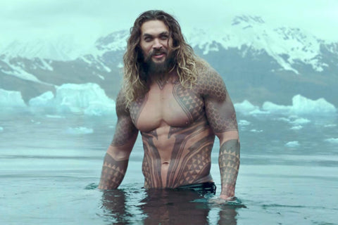 Jason Momoa as Aquaman, topless in water
