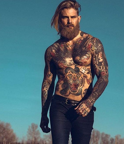Model Kevin Creekman topless with loads of tatts