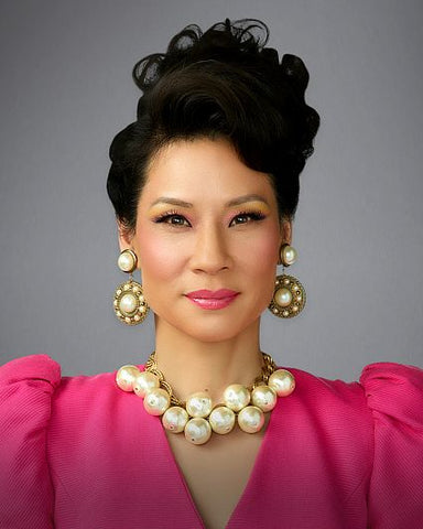 lucy liu with beehive and big pearls