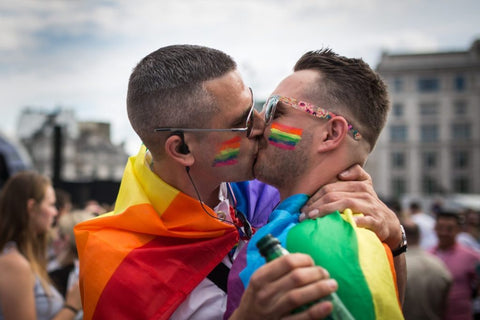 Two men kiss at Pride event