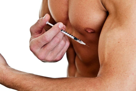 muscly man injecting arm