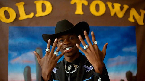 Lil nas x in old town road with hands up