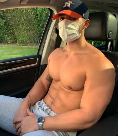 topless guy in car with mask and cap