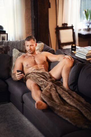 austin wolf with brown furry rug