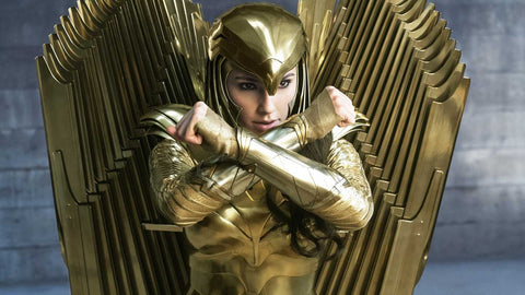 Gal Gadot as Wonder woman in gold armour