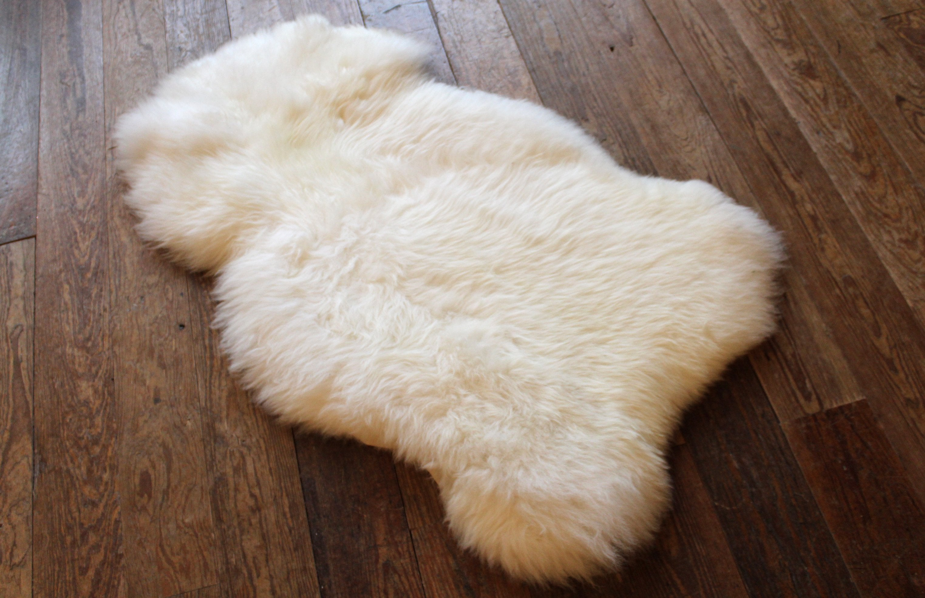 natural sheep skin rug on a wooden floor
