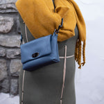 Gaia Soft Leather Italian Handbag in light blue on a vintage mannequin