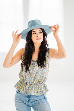 Blue hat with a floral smocked tank top