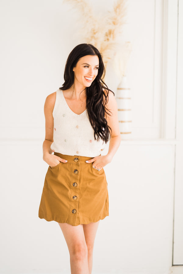 Camel Scalloped Mini Skirt paired with a multi dot tank
