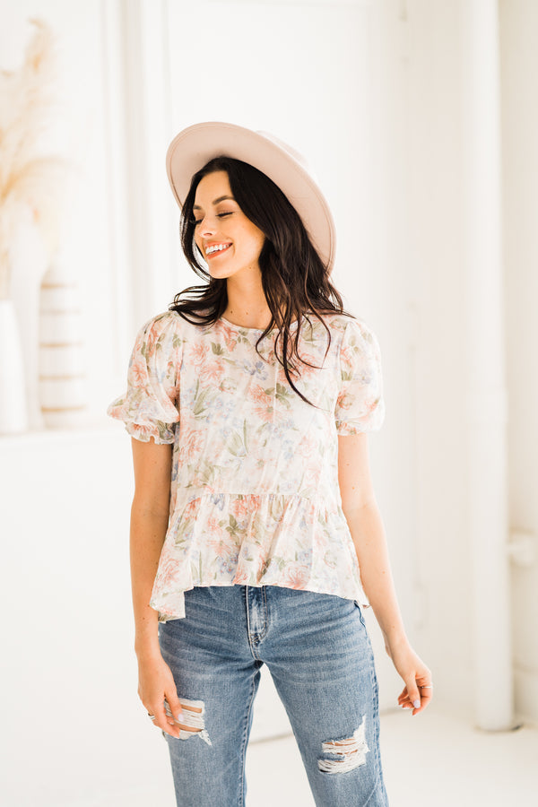 Pastel floral peplum top with ruffle sleeves