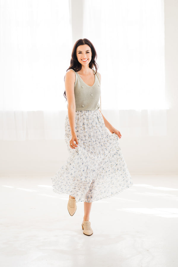 white maxi skirt with blue florals paired with a sage green tank