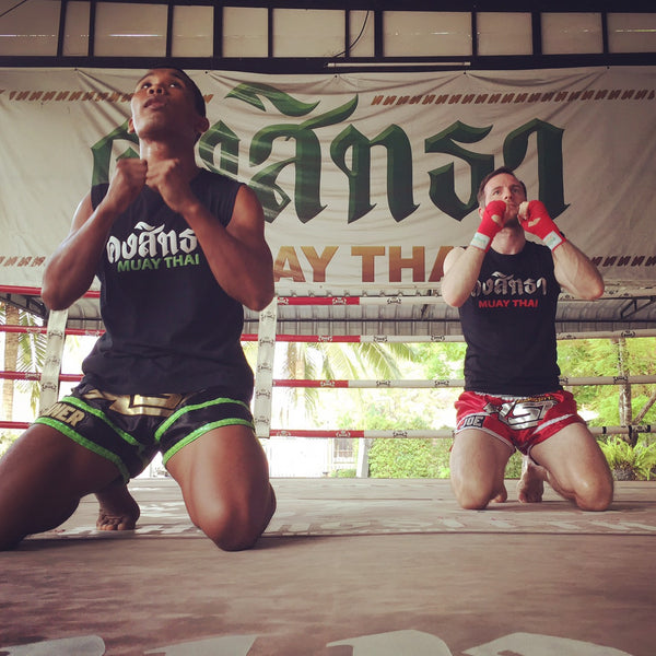 "Joe Gebbia and Sueadam ""Black Tiger"" Khongsittha doing the Wai Kru to pay respect to their teachers."